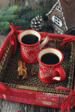 Cups of coffee and cinnamon sticks, burning candles and  pine co Stock Images