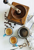 Cups of coffee, coffee pot and coffee grinder. Stock Photography