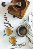 Cups of coffee, coffee pot and coffee grinder. Stock Photo