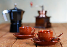 Cups of coffee and a coffee pot on a  table Stock Photo