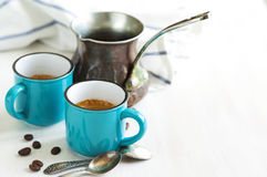 Cups of coffee and coffee pot. Stock Image