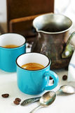 Cups of coffee and coffee pot. Stock Photography