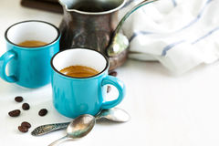 Cups of coffee and coffee pot. Royalty Free Stock Photo