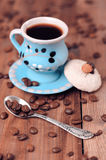 Cups of coffee with cookie. Homemade almond cookie with cup of coffee, selective focus Royalty Free Stock Photography