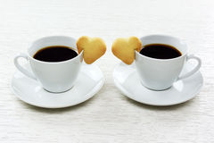 Cups of coffee with cookies Stock Photo