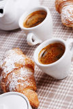 Cups of coffee with croissant Royalty Free Stock Images