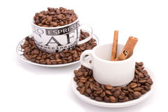 Cups of coffee, full of beans Royalty Free Stock Image