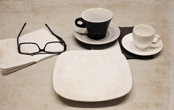 Cups of coffee, glasses, empty plate Royalty Free Stock Image