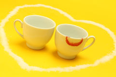 Cups of coffee inside a heart, one of them with lipstick Royalty Free Stock Photo