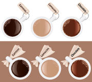 Cups of coffee with labels Royalty Free Stock Photos