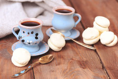Cups of coffee with meringues. Morning coffee with cookies closeup, selective focus Royalty Free Stock Image