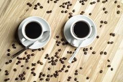 Coffee cups and coffee beans Royalty Free Stock Images