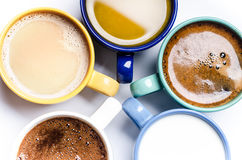 Cups of coffee, milk, juice, cappuccino. Isolated on a white background. Colorful cups. Glasses placed in a circle. Energy backgro Stock Photos