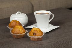 Cups of coffee and muffins Stock Image
