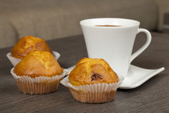 Cups of coffee and muffins Stock Photos