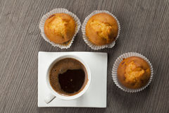 Cups of coffee and muffins Stock Photography