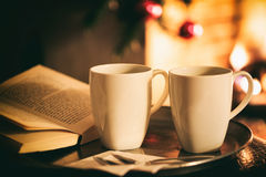 Cups of coffee near a fireplace stock photography