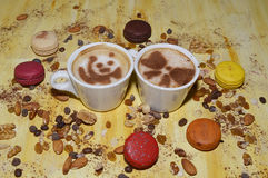 Cups of coffee with nuts, cookies and cinnamon royalty free stock photography