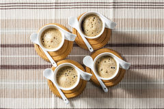 Cups of coffee. On place mats Royalty Free Stock Photo