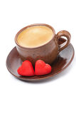 Cups of coffee and red candy in the the shape of heart Stock Photography