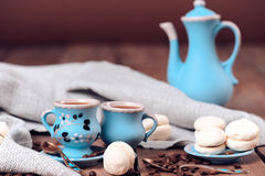 Cups of coffee with sweets. Cookies with cups of coffee, coffee pot, selective focus Stock Photo