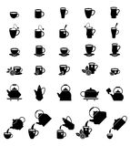 Cups for coffee and tea. A large set of vector icons of teapots and cups for coffee and tea. Vector illustration isolated on white background stock illustration