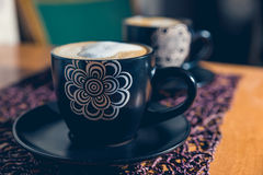 Cups of coffee. Two cups od cappuccino on the table Stock Images