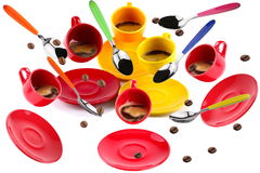 Cups of coffee. On white background in motion with flying spoons and coffee beans Royalty Free Stock Images