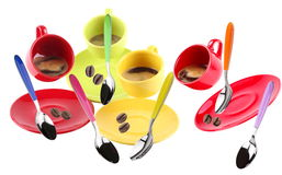 Cups of coffee. On white background in motion with flying spoons and coffee beans Stock Image