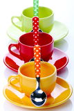 Cups of coffee. On white background with spoons Royalty Free Stock Image