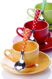 Cups of coffee. On white background with spoons Stock Photos