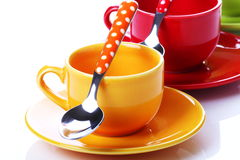 Cups of coffee. On white background with spoons Royalty Free Stock Images
