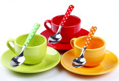 Cups of coffee. On white background with spoons Royalty Free Stock Photos