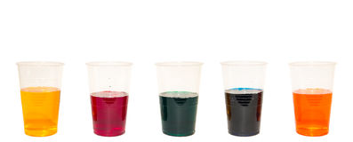 Cups with colorful liquid Stock Photography
