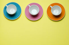 Cups on colorful saucers Royalty Free Stock Photography