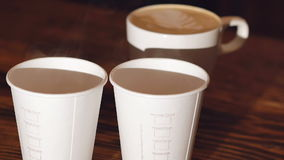 Cups of delicious coffee on the wooden table. Slowly stock footage