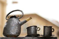 cups den gammala teapoten Royaltyfri Bild