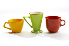 Cups of different colors royalty free stock photography