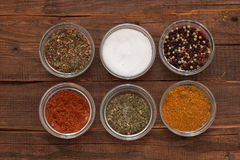 Cups with different spices stock images