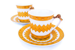 Cups with dishes Stock Images