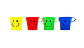 Cups with drawing in a kind of smile Royalty Free Stock Photos