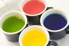 Cups of Dye and Eggs. Cups of Dye and Easter Eggs royalty free stock images