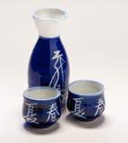 cups flaskasake Arkivfoton