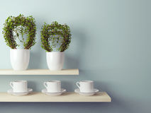 Cups and flowerpot on the shelf. Stock Photos