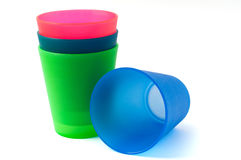 Cups. Four different coloured childrens plastic cups Royalty Free Stock Photo