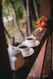 Cups with fresh tea standing on a balcony Stock Photos