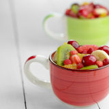 Cups with fruits Stock Image