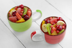 Cups with fruits Royalty Free Stock Photography