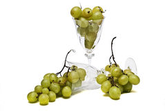 Cups and grapes. Stock Image