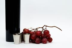 Cups, grapes, vine still life Stock Image
